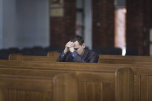 38789205 - man praying in church